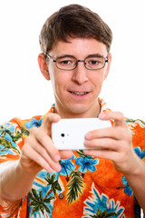 Face of happy man smiling while taking picture with mobile phone