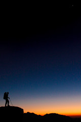 silhouette of man on top of mountain