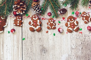 Christmas background with homemade Gingerbread cookies garland, top view