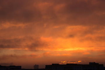 clouds at dawn. Fiery red rising sun behind the clouds. headpiece