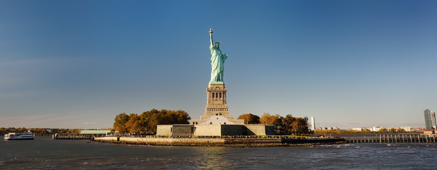 Panorama of island of Liberty with statue of Liberty seen from the ferry in the Hudson river.