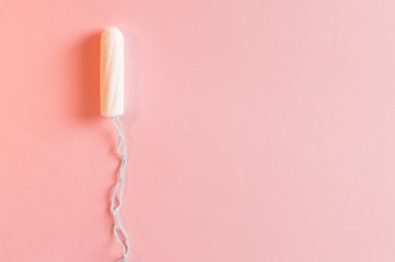 Cotton tampon. Menstrual cramps. Womens comfort, hygiene and protection.