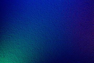 Light green spot on a blue textural background