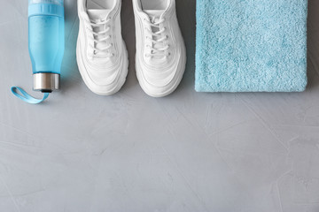 Flat lay composition with fitness equipment and space for text on gray background Wall mural