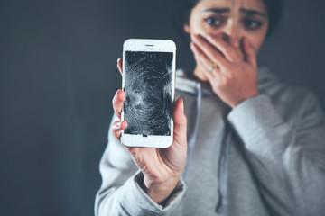 Obraz sad woman hand broken phone - fototapety do salonu