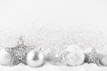 Christmas greeting card. Festive decoration on bokex silver background. New Year concept. Copy space.  Flat lay. Top view.