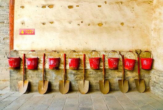 Eight fire buckets hung on a wall