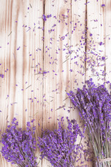 three lavender dried flowers bouquets on wooden desk, top view