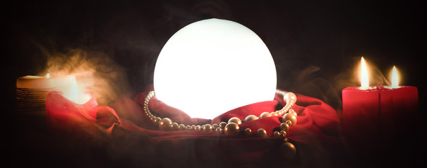 Crystal ball on the magic table background. Future reading. Wall mural
