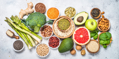 Superfoods, healthy food on light background.