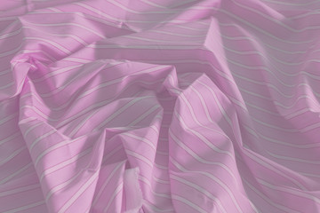 Close-up of smooth elegant satin texture of blue and white stripes. Cloth luxury background. Fashion Concept.