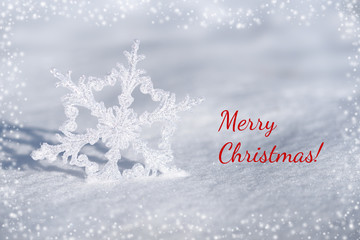 Christmas card with snowflake decoration and snow
