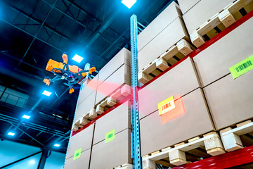 Drones scans barcode. Modern warehouse. Inventory in stock. Drone reads the barcode boxes in stock. Automation. Storage management. Responsible storage. Warehouse inspection. Wall mural