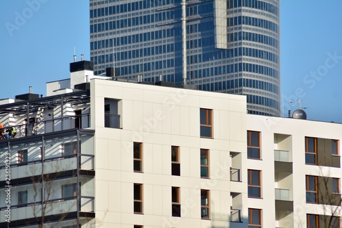 Modern Apartment Buildings On A Sunny Day With Blue Sky Facade Of