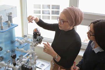 Technical vocational training with young female muslim teacher. Education and technology concept.