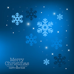 Blue holiday background with snowflakes for Christmas.