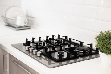Modern built-in gas cooktop in light kitchen