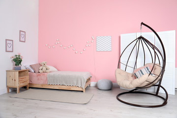 Cozy child's room interior with comfortable bed
