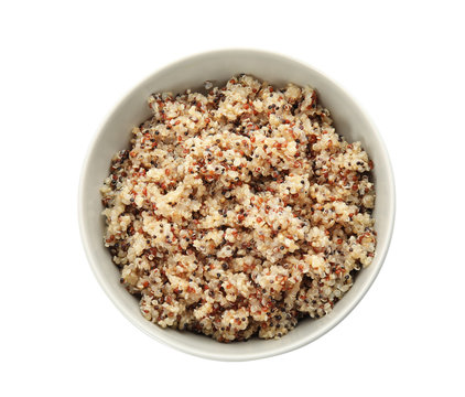 Cooked delicious quinoa in bowl isolated on white, top view