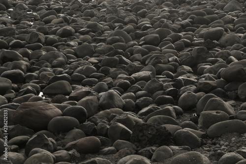Smooth Black Beach Stones Background