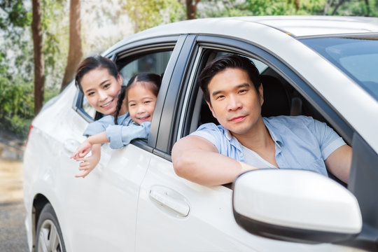 Happy enjoy Asian family in car driving to travel in weekend