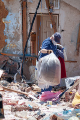 Unrecognizable Man Cleaning Up After a Tornado Strike