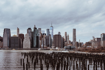 View of the Manhattan skyline from Brooklyn Heights, New York. Cloudy spring day