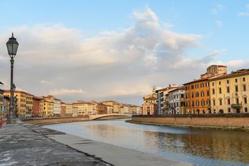 View on embankment of Arno river and bridge Ponte Di Mezzo. Pisa, Italy