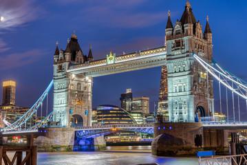 The illuminated Tower Bridge in London at night