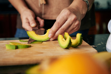 Peeling cut avocado