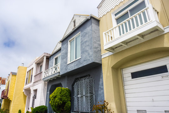 Street view of rows of houses in one of the San Francisco's residential neighborhoods, California