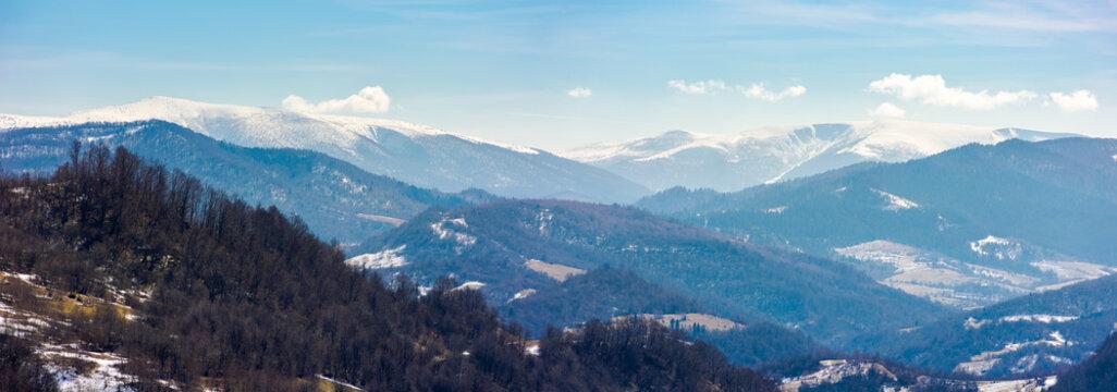 rolling hill and mountain ridge panorama