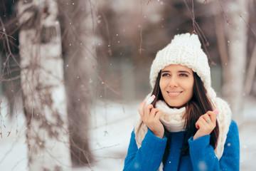 Happy Woman Applying Lip Balm Outdoors in Winter