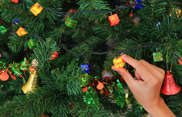 Hand holding magic gift from Christmas decorative. Merry Christmas and Happy New Year concept.