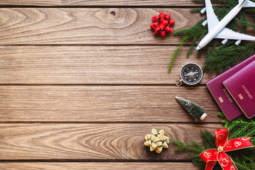 Merry Christmas and Happy new years travel concept background for winter trip on wood background , Travel with airplane top view with copy space.