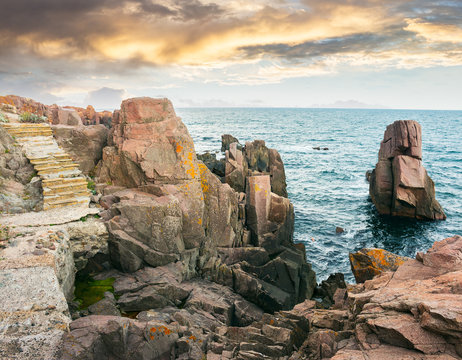 stone steps on rocky cliffs above the sea