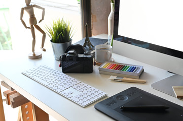 Creative workspace with office desk table.