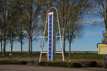 Statue at highway A20 to mark the lowest point of the Netherlands, 21 feet below sea level in Zuidplaspolder in Nieuwerkerk aan den IJssel
