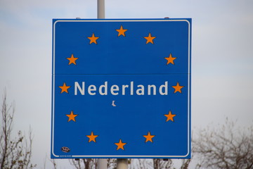 Sign at the border of the Netherlands with european stars and name Nederland
