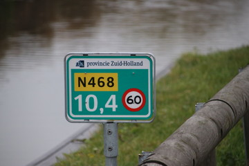 Distance sign on provincial road N468 at Schipluiden in the Netherlands with speed limit 60 kilometers