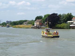 Small ferry over river Hollandsche IJssel between Ouderkerk en Nieuwerkerk aan den IJssel.