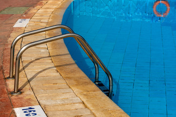 Blue Swimming Pool with a Steel Ladder