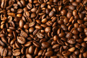 Dark roasted coffee beans. Natural coffee background