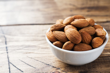 Almonds in a bowl. Selective focus Close up