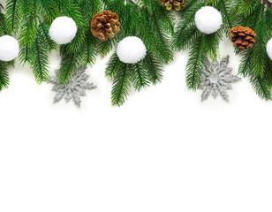 Christmas tree branches with decoration isolated on white background.
