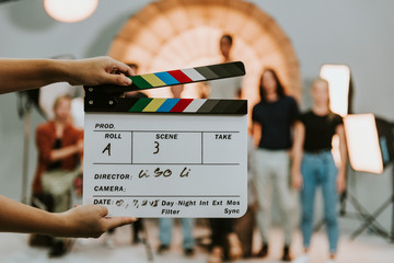Woman holding a movie production clapperboard