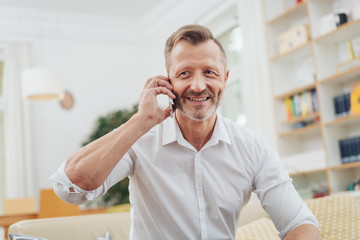 older man listening to a mobile call