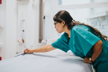 Nurse making the bed at a hospital