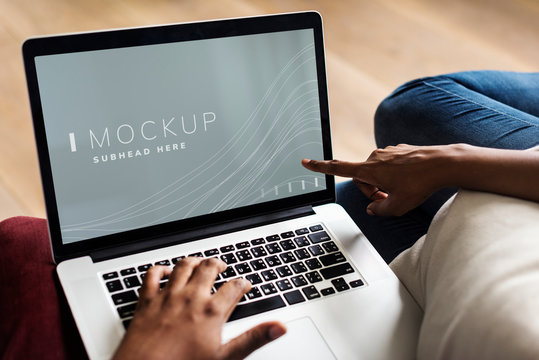 Woman pointing at a laptop screen mockup