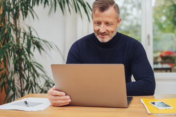 Businessman working from home on a laptop